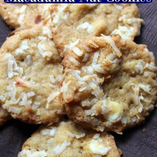 Coconut macadamia nut cookies sitting on a brown paper napkin