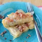 Crock Pot Cabbage Rolls Recipe is so easy to make! Stuffed cabbage rolls are a delicious family dinner! This slow cooker recipes combines cabbage, kielbasa, bacon and more for a great meal!