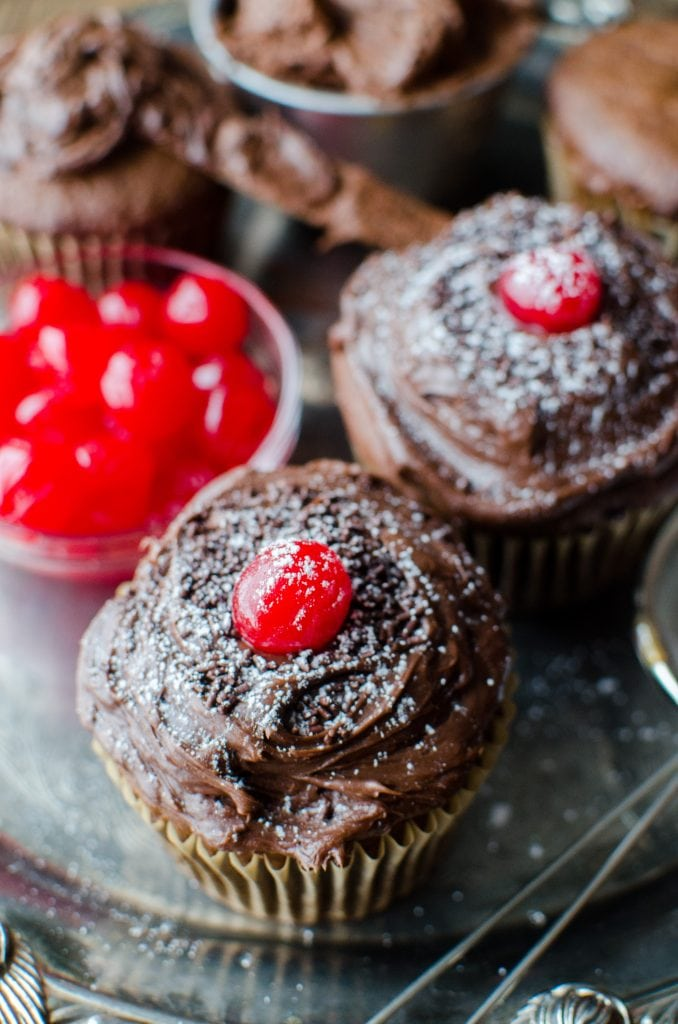 Easy Black Forest Cupcakes Recipe you will love! A delicious German treat that tastes so good! Made with cake mix, cherries and more!