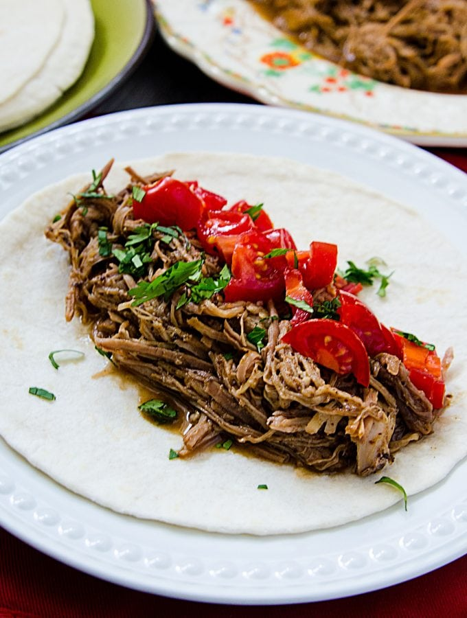 Slow Cooker Crock Pot Mole Pulled Pork Recipe that is perfect for family dinner! So good in burritos or tacos! #comfortfood #crockpot #slowcooker #pulledpork #pork #recipe