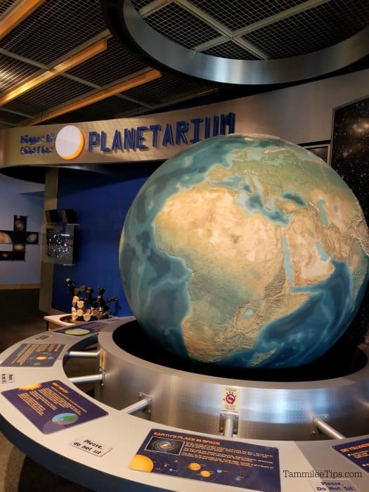 Large globe and space exhibit outside the entrance to the Grand Rapids Public Museum planetarium