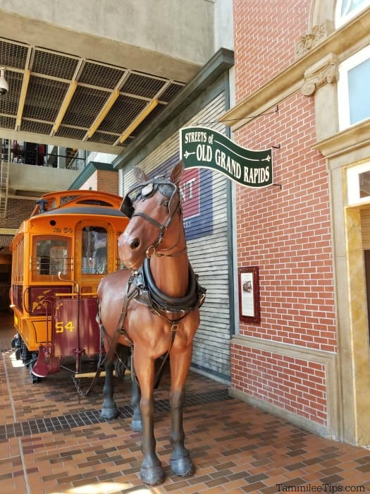 Replica of a horse and streetcar with Streets of Old Grand Rapids Sign in the Grand Rapids Public Museum